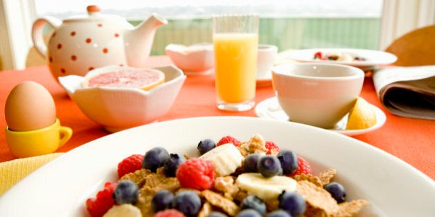 Healthy breakfast of dry cereal and fruit with egg and