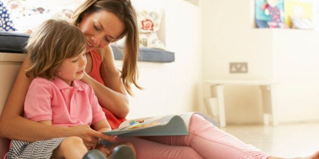 Mother Sitting With Son Reading Story