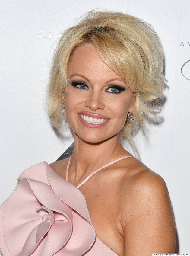 TIFF 2016: Pamela Anderson Stuns In Pink Gown At AMBI