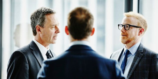 Group of business executives having informal meeting in