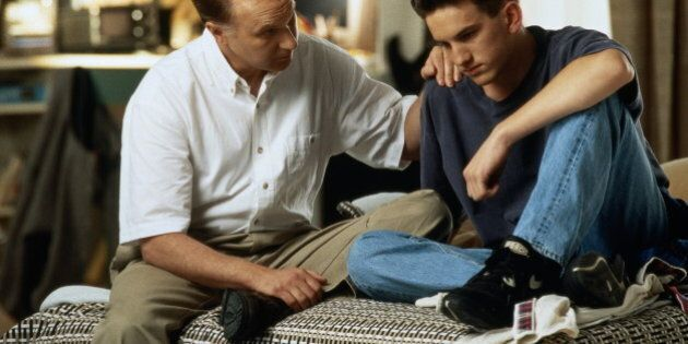 Father talking to teenage son