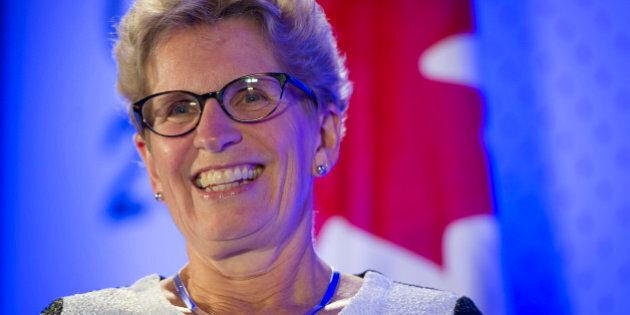 Kathleen Wynne, premier of Ontario, smiles during an interview at the Bloomberg Canada Economic Summit in Toronto, Ontario, Canada, on Thursday, May 21, 2015. The investment banking fee structure for the initial public offering of Hydro One Inc. hasn't been finalized, despite 'speculation' about the process, Wynne said today. Photographer: Kevin Van Paassen/Bloomberg via Getty Images