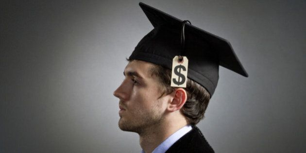 College graduate wearing tuition price tag on mortarboard,