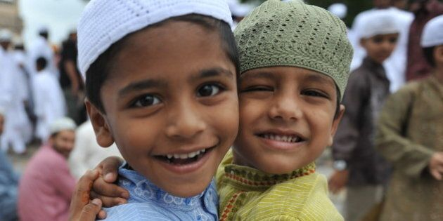 Indian Muslims boys greet one another after Eid al-Fitr prayers at the Qutub Shahi tomb in Hyderabad...
