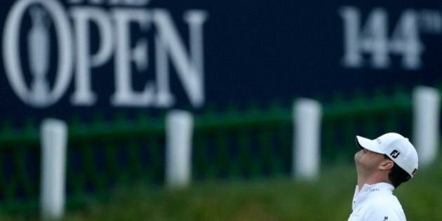 United States' Zach Johnson reacts after winning a playoff after the final round at the British Open...