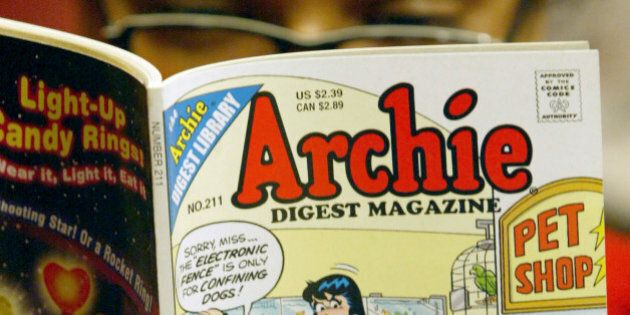 FILE- In this Monday, May 7, 2007, file photo, a girl reads an Archie comic at Oxford Book Shop in Calcutta,...
