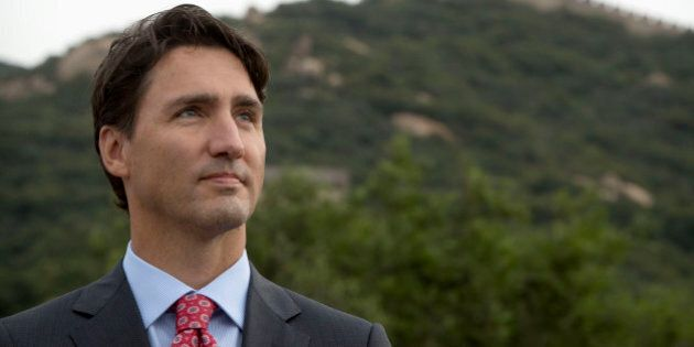 Canada's Prime Minster Justin Trudeau stands on the Badaling section of the Great Wall in Beijing, China,...