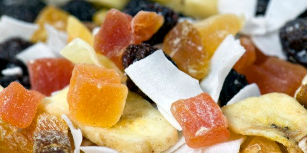 Close up of dried fruit, nut and coconut, often called trail mix.
