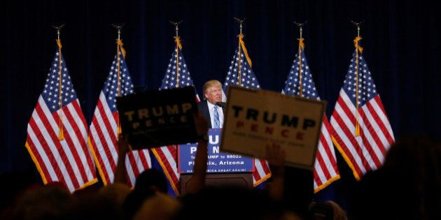 Republican presidential nominee Donald Trump speaks at a campaign rally in Phoenix, Arizona, U.S., August...