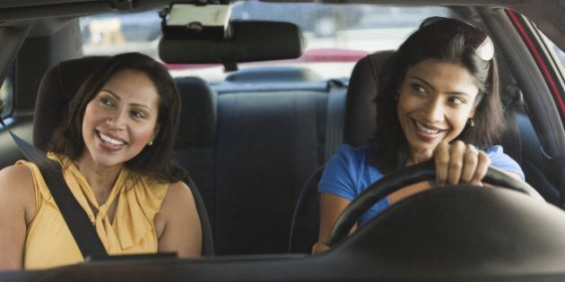 Friends driving in car together