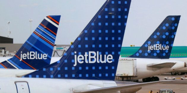 JetBlue Airways aircrafts are pictured at departure gates at John F. Kennedy International Airport in...