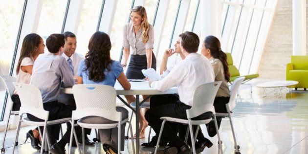 Business People Having Board Meeting In Modern