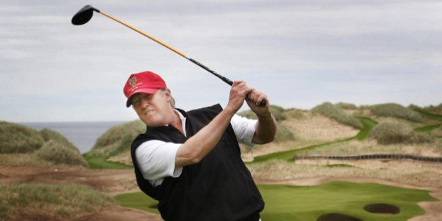 Donald Trump views developments to his luxury golf resort during a visit to the Menie estate in