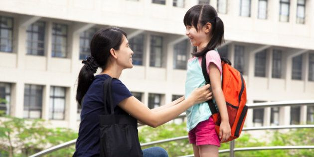 back to school.happy asian mother with daughter in