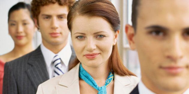 portrait of two businessmen and two businesswomen in a