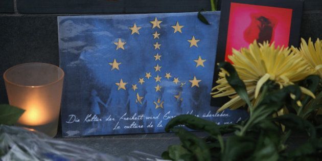 BERLIN, GERMANY - MARCH 22: A peace sign combined with the flag of the European Union lies among flowers...