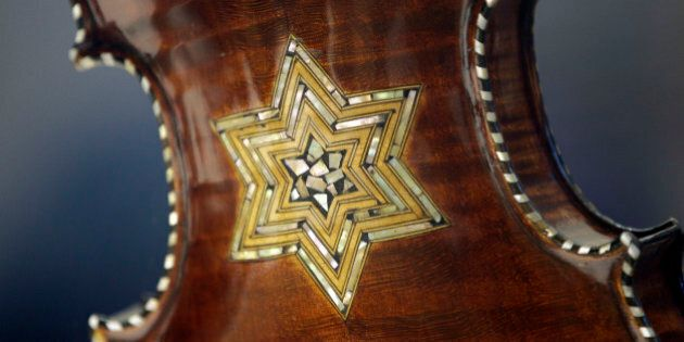 In this April 9, 2012 photo, the back of a violin showing a Star of David is shown on display at the...