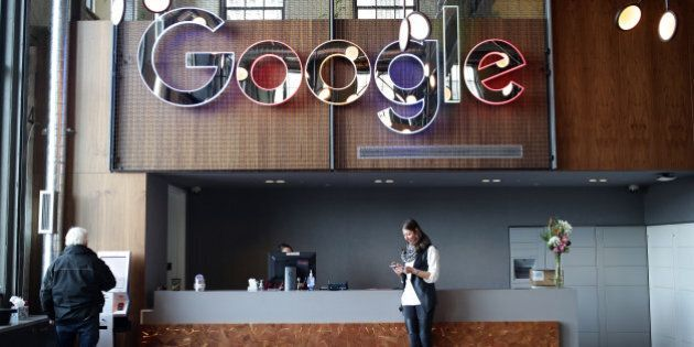 An employee checks her mobile device in the lobby of Google Canada's engineering headquarters in Waterloo,...