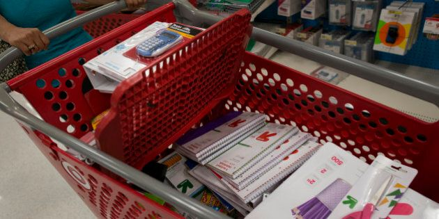 Back to school supplies sit inside a customer's shopping cart at a Target Corp. store in Colma, California, U.S., on Saturday, Aug. 9, 2014. Retailers are pushing for a longer shopping season and earlier than ever deals on order to get customers to buy more over a longer period of time, says DealNews spokesman Mark LoCastro, which tracks price and discount trends across the web, according to USA Today. Photographer: David Paul Morris/Bloomberg via Getty Images
