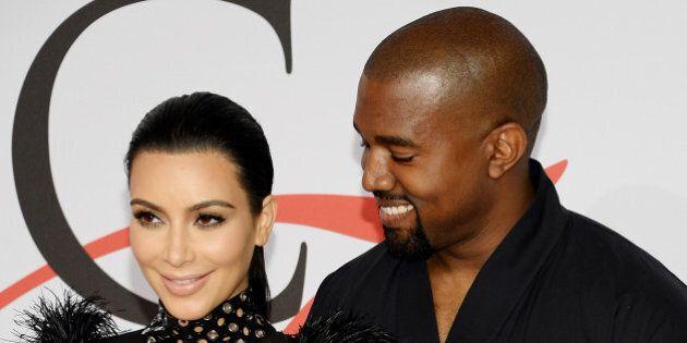 Kim Kardashian West and Kanye West arrive at the 2015 CFDA Fashion Awards at Alice Tully Hall on Monday,...