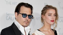 Amber Heard Charged With Illegally Bringing Dogs To