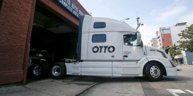 One of Otto's self-driving, big-rig trucks leaves the garage for a test drive during a demonstration at the Otto headquarters on Thursday, Aug. 18, 2016, in San Francisco. Uber announced that it is acquiring self-driving startup Otto, which has developed technology allowing big rigs to drive themselves. (AP Photo/Tony Avelar)