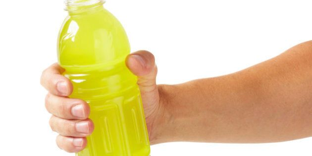 Hand holding sports drink, larger files come with clipping