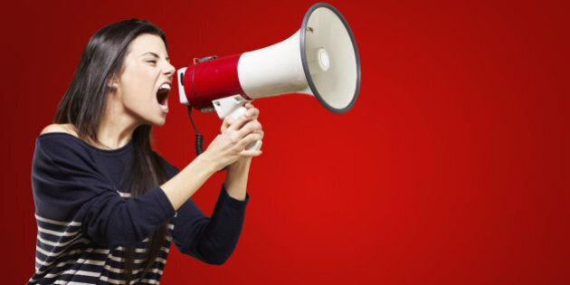 young woman shouting with a...