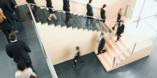 Businesspeople walking down office