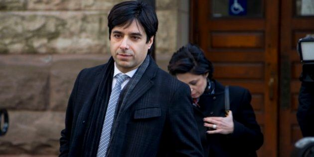 TORONTO, ON - FEBRUARY 11: Jian Ghomeshi (middle) leaves with co counsel Danielle Robitaille (left) and...
