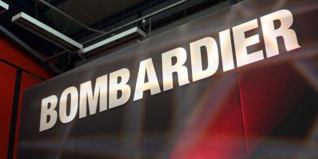A Bombardier logo sits on a presentation platform at Bombardier Inc.'s Litchurch Lane railcar factory...