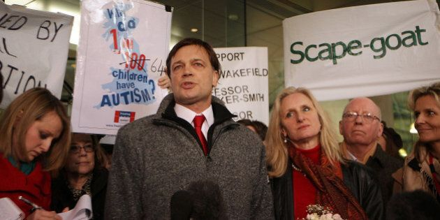 LONDON, ENGLAND - JANUARY 28:  Dr Andrew Wakefield (C) stands with his wife Carmel as he talks to reporters at the General Medical Council (GMC) on January 28, 2010 in London, England. Dr Wakefield was the first clinician to suggest a link between autism in children and the triple vaccination for measles, mumps and rubella known as MMR. Today's GMC ruling states that he had acted 'dishonestly and irresponsibly' in carrying out his research. Vaccination take up rates dropped dramatically after Dr Wakefield's research was published in 1998.  (Photo by Peter Macdiarmid/Getty Images)