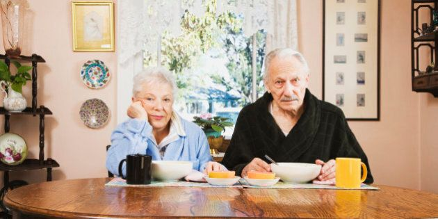 Senior couple at breakfast table