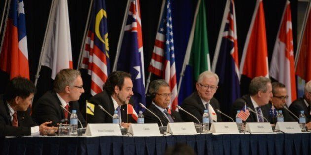 Trade representatives attend at a press conference for the Trans-Pacific Partnership (TPP), a pan-Pacific...