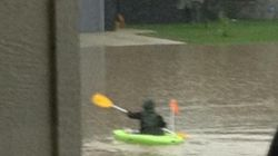 Locals Kayak The Streets After Flooding In Southern