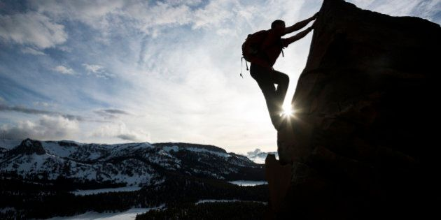 mountain climber going to the