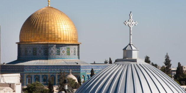 The silver dome of Our Lady of the Spasm Armenian Catholic Church and the golden Dome of the Rock rise over the Old City of Jerusalem.