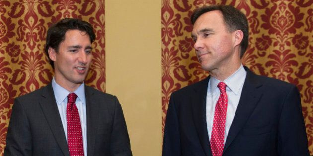 Scott Brison, finance spokesperson of the Liberal Party of Canada, from left, Justin Trudeau, leader...