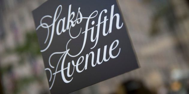 The Saks Fifth Avenue logo is displayed at the company's store in New York, U.S., on Monday, July 29,...