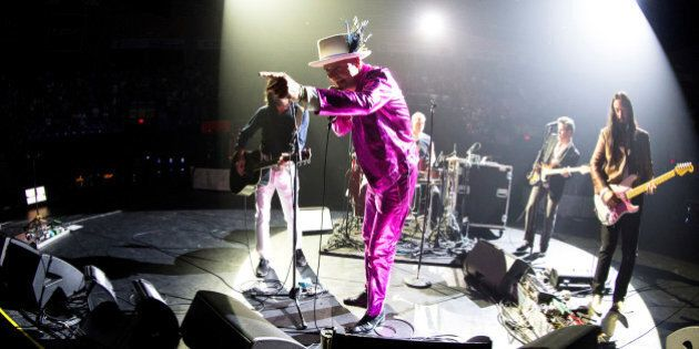 Tragically Hip lead singer Gord Downie performs with band members Paul Langlois, Gord Sinclair, Johnny...