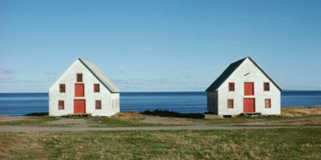Twin houses by ocean, Magdalen Island, Quebec,