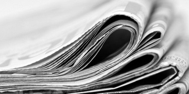 A stack of newspapers,