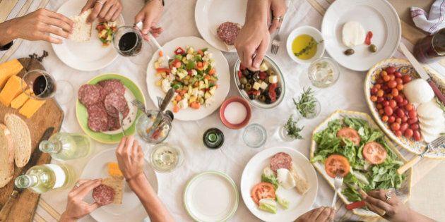 USA, New Jersey, Jersey City, Friends having dinner