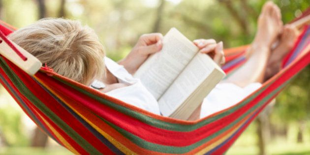 Senior Woman Relaxing In Hammock With