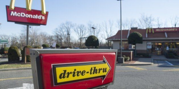 A McDonalds fast food restaurant is seen in Alexandria, Virginia, December 30, 2014. AFP PHOTO / SAUL...