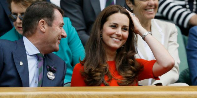 Kate, the Duchess of Cambridge, right, sits next to All England Lawn Tennis Club Chairman Philip Brook...