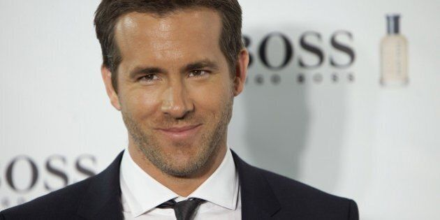 Canadian actor Ryan Reynolds poses for photographers during the 15th Anniversary of Boss Bottled Photocall at Eurostars Hotel in Madrid, Spain. Tuesday Nov. 26, 2013. (AP Photo/Abraham Caro Marin)