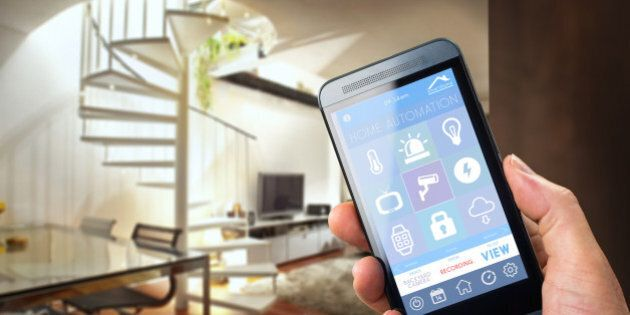 smart house, home automation, device with app icons. Man uses his smartphone with smarthome security...