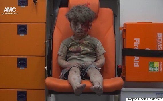 Haunting Image Of Boy In Ambulance Shows Reality Of Syria's