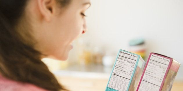 Woman reading nutrition facts on food